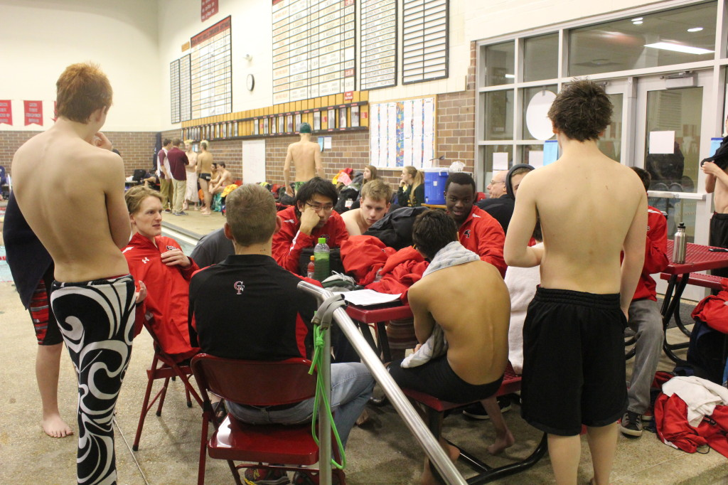 The team huddles during a recent meet. Photo by Kylee Ferrell.