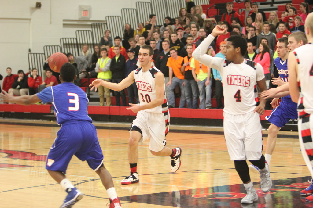 The JV team breaks down one of their final hudles of the year in the team's final game, a home win against Waterloo East. After finishing the season 2012-2013 without a win, the 2013-2014  Cedar Falls Tiger men's junior varsity basketball team finished the season an undefeated 6-0.