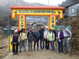 The group walking from the village of Ghorepani to view Poon Hill about 45 minutes more uphill. From left to right: two porters, Morey Lindquist, Honor Heindl, Luke Heindl, Sami Schildroth, porter, Diane Heindl and Mike Heindl.