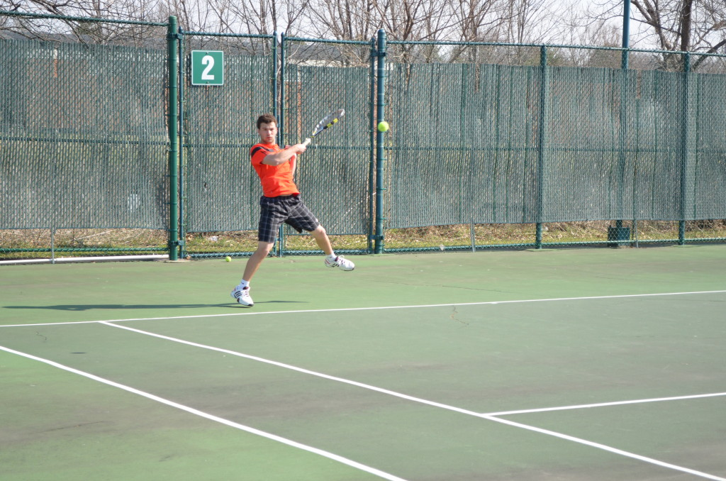 Senior Brennan Ashwood emerged victorious in his singles and doubles matches against Dubuque Senior, leading the team to an 8-1 victory.
