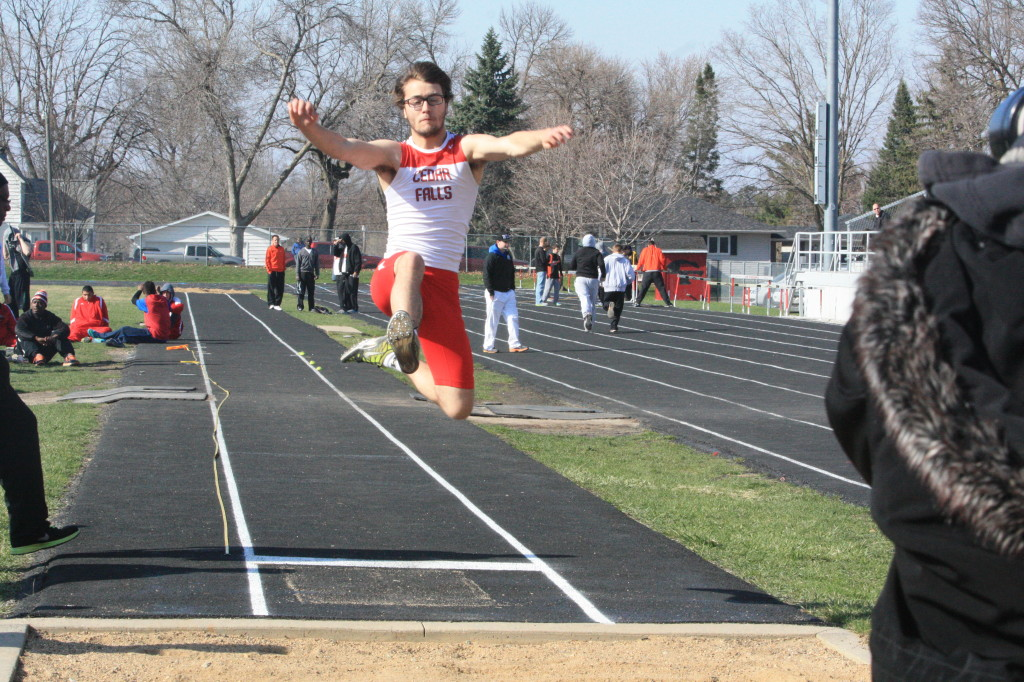 Senior Trevor Balm long jumps at the Cedar Falls Invitational on April 5 at the Cedar Falls High School track.