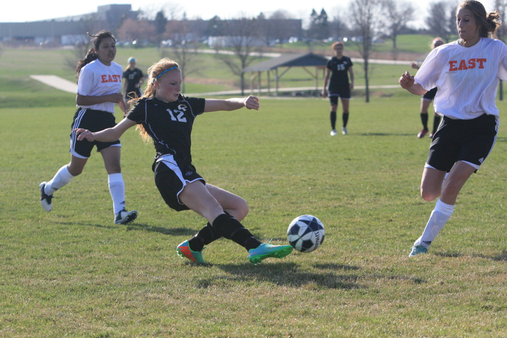 The Tigers compete in a women's soccer match against Waterloo East.