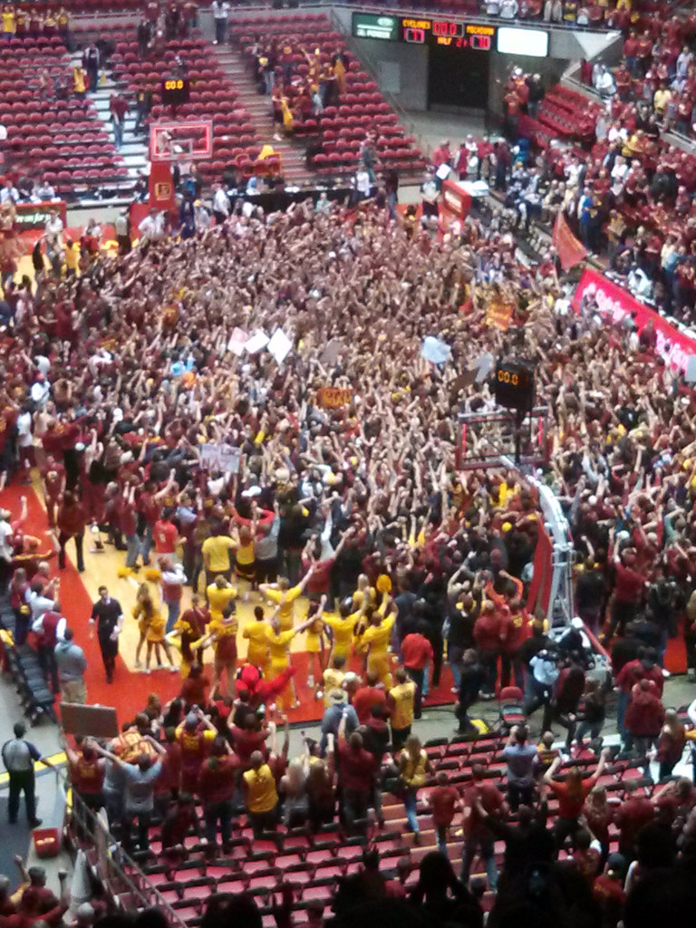 The Iowa State student section rushed the court after a big early season upset of then No. 7 Michigan.
