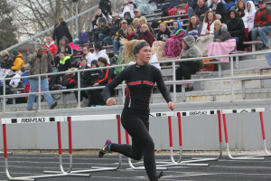 Senior Maddie Smith races through hurdles last year.