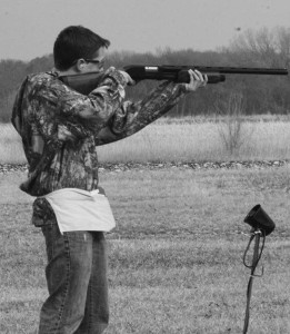 "Taking aim, sophomore Josh Osterhaus uses his PA-08 WeatherB 12 gage pump action. ""I use this gun because I'm used to shooting it, and it comes easy to me,"" Osterhaus said."