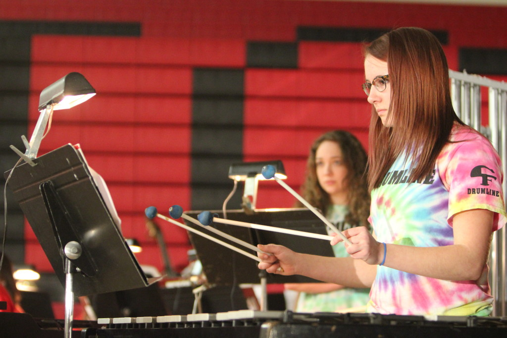 Savannah Lipinski plays mallets with the Wind Symphony.
