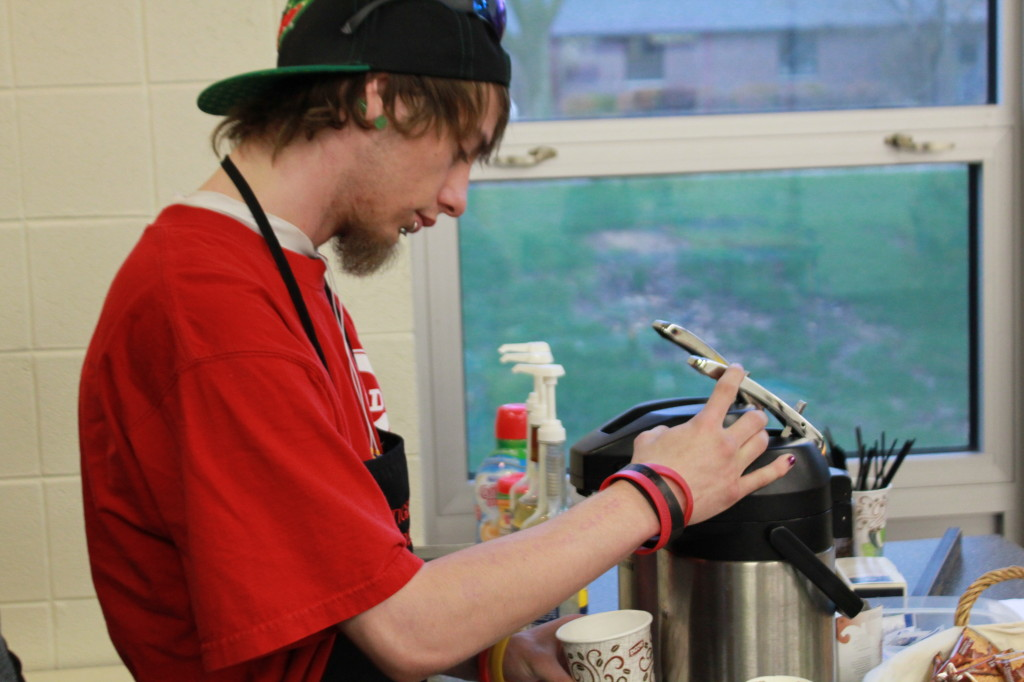 Brad Elemr watches carefully as he fills up a fresh cup of coffee with a steady hand during his shift in the Tiger Den's Coffee Shop. (Mackenzie Dallenbach photo)